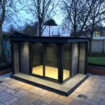 Centered Composite Garden Building With Lit Up Interior