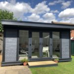 Composite Garden Building With Double Doors And Grey Panels
