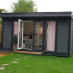 Composite Garden Building With French Style Bi Fold Doors And Flyover
