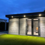 Light Grey Composite Garden Building At Dusk