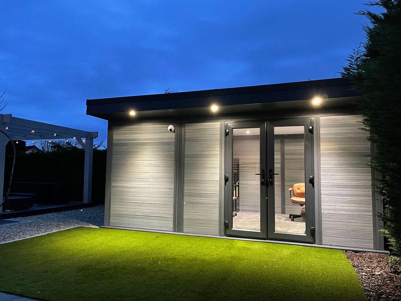 Light Grey Composite Garden Building At Dusk