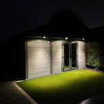 Light Grey Composite Garden Room At Night