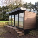 Walnut Garden Room Built Into Slope With Matching Steps
