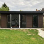 Walnut Garden Room With Bi Folds And Storage Area