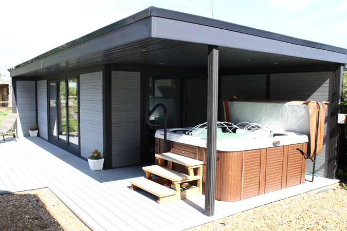 Garden room with hot tub under roo canopy