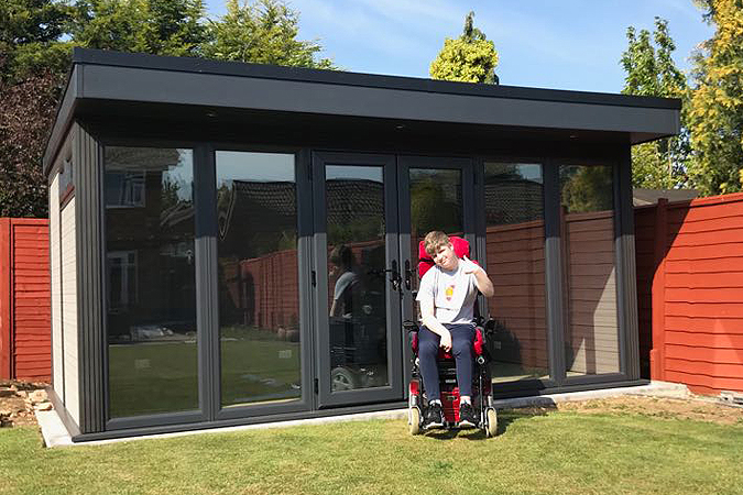 Garden Play Room For Disabled Boy In Wheelchair