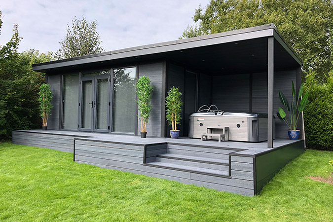 an upgraded composite garden room with bespoke decking and flyover to house a jacuzzi