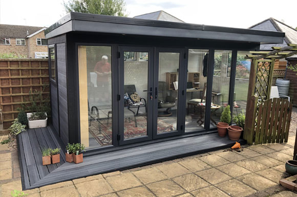 Composite Garden Room With Low Decking